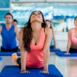 Stock Photo: People stretching at the gym