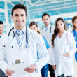 Stock Photo: Male doctor with medical group