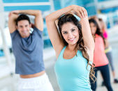 People stretching at the gym — Stok fotoğraf