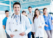 Male doctor with a medical group — Stock Photo