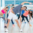 Gym people stretching — Stock Photo