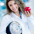 Nutritionist holding weight scale — Stok fotoğraf
