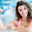 Gym woman measuring her arm — Stock Photo