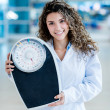 Doctor holding weight scale — Stock Photo #31701131