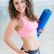 Gym woman holding yoga mat — Stock Photo #31701181