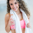 Stock Photo: Womhydrating after gym