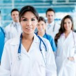 Doctor with her team — Stock Photo #31704349
