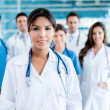 Doctor with her team — Stock Photo