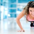 Gym woman doing push ups — Stock Photo #31704677