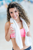 Woman hydrating after the gym — Stock Photo