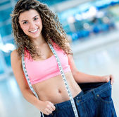 Fit woman loosing weight — Stock Photo