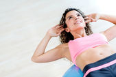 Gym woman doing crunches — Stock Photo