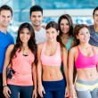 Stock Photo: Happy people at gym
