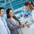 Doctor handshaking couple — Stock Photo #31843327