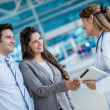 Doctor handshaking a couple — Stock Photo