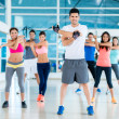 Stock Photo: People exercising at gym