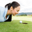 Stock Photo: Golf player blowing ball