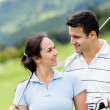 Couple playing golf — Stock Photo