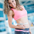Gym woman measuring her waist — Stock Photo
