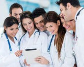 Doctors using a tablet computer — Stock Photo