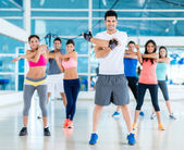 People exercising at the gym — Stock Photo