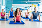 Gym people in a yoga class — Stock Photo