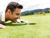 Golf player cheating — Stock Photo