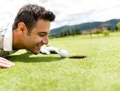 Golf player cheating — Stock Photo