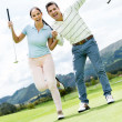 Happy couple playing golf — Stock Photo