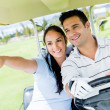 Couple at the golf course — Stock Photo