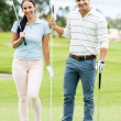 casal jogando golfe — Foto Stock