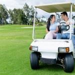 pár v golfový vozík — Stock fotografie