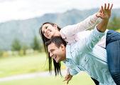 Beautiful couple flying — Stock Photo