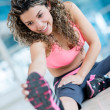 Athletic woman stretching — Stock Photo