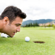 Golf player blowing the ball — Stock Photo #32068961