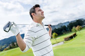 Golf player at the course — Stock Photo