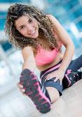 Gym woman stretching — Stock Photo