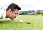 Golf player blowing the ball — Stock Photo