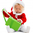 Stock Photo: Girl opening Christmas gift