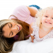 Mother tickling her daughter — Stock Photo