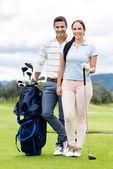 Couple playing golf — Foto de Stock