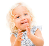 Happy little girl clapping — Stock Photo