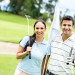 Couple playing golf — Stock Photo