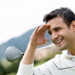 Golf player looking away — Stock Photo