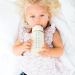 Baby girl drinking from a bottle — Stock Photo