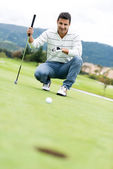 Man playing golf — Stok fotoğraf