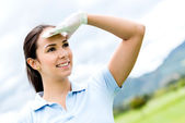 Woman at the golf course — Stock Photo
