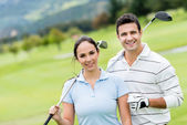 Couple of golf players — Stock Photo