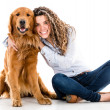 Happy woman with a dog — Stock Photo #32409989