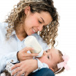 Mother feeding her baby — Stock Photo #32409997